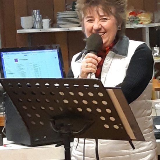 Linda singing Christmas music at local restaurant